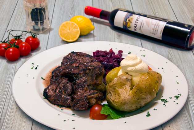 Kastro Oia Restaurant Santorini. Beef fillet with baked potato, fennel and red wine sauce.